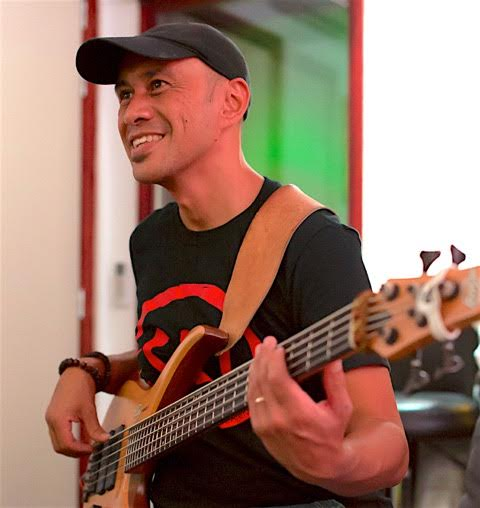Roger Bass guitar hero player